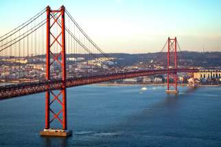 the 25 abril bridge over the tagus river