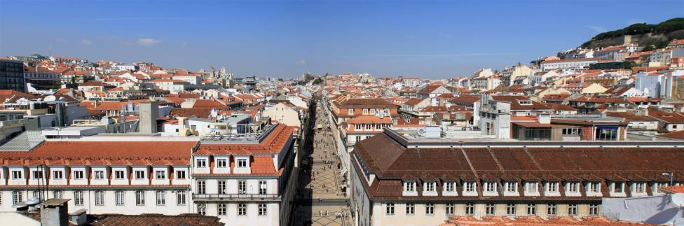view from the st augustus arch in lisbon on the orange rooftop witha blue sky