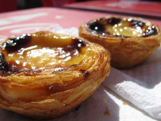 portuguese eggtart on a table with paper napkins served in our gourmet food tours in Lisbon at Treasures of Lisboa