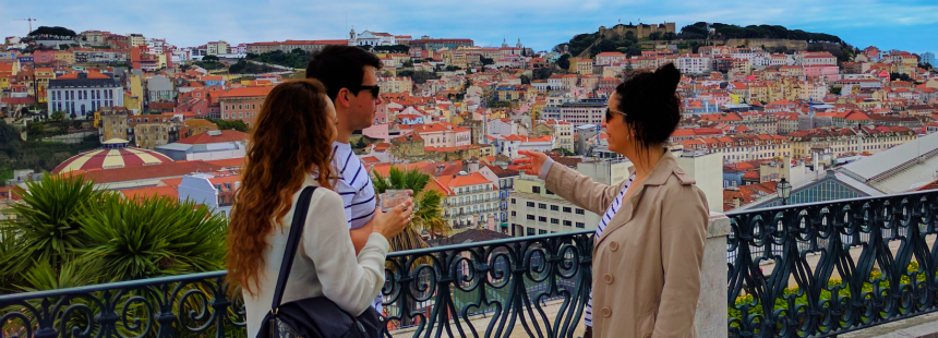 a man and a woman enjoying a ginginha under lisbon's blue sky during a private gourmet food tours in Lisbon with Treasures of Lisboa