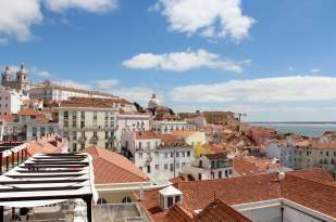 awesome point of view of lisbon's rooftops and pantheon with tagus river