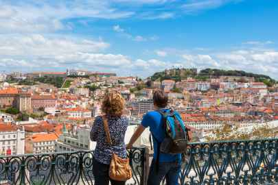 two tourists watching the beautiful view of Lisbon under a blue sky during our Gourmet Food tours at Treasures of Lisboa