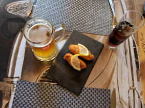 codfish cakes with beer served in our gourmet food tours in Lisbon at Treasures of Lisboa