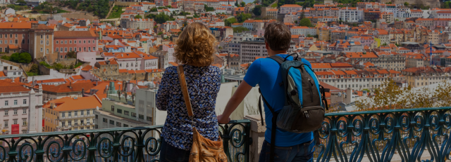 two tourists enjoying the incredible view of rooftop in lisbon