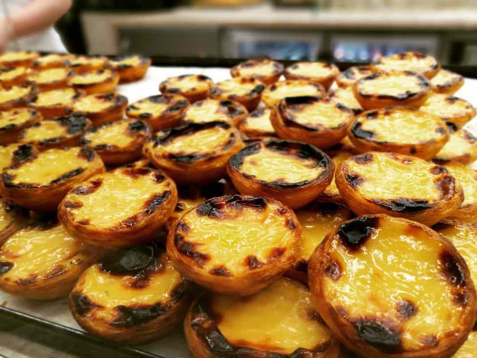 the portuguese eggtarts called pasteis de nata served in our food tours in Lisbon at Treasures of Lisboa
