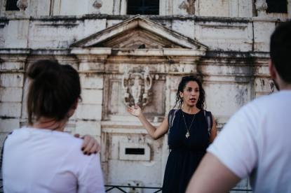 Ruthy the best guide in Lisbon giving an explanation about the city of Lisbon on our gourmet food tours