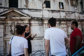 Ruthy our guide explaning historical facts about Lisbon during our gourmet food tours in Lisbon at Treasures of Lisboa