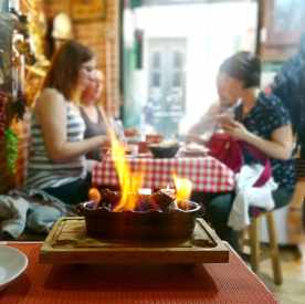 flammed sausage called chouriçoserved in our gourmet food tours in Lisbon at Treasures of Lisboa