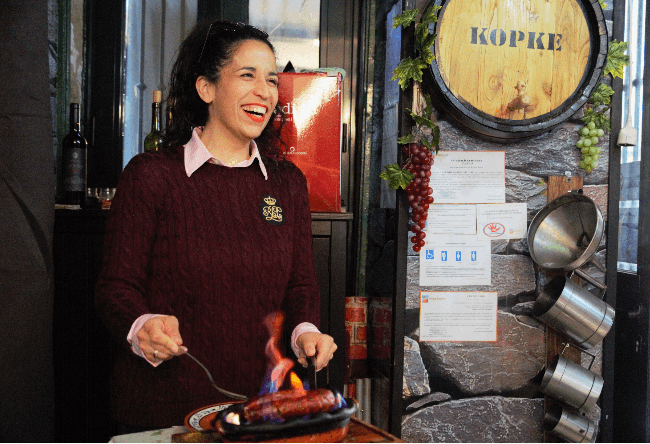 treasures of lisboa food tours in lisbon - ruthy grilling sausage