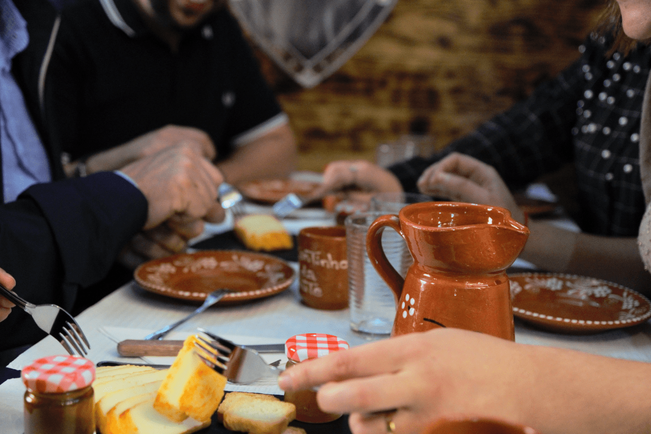 treasures of lisboa food tours in lisbon - group eating cheese