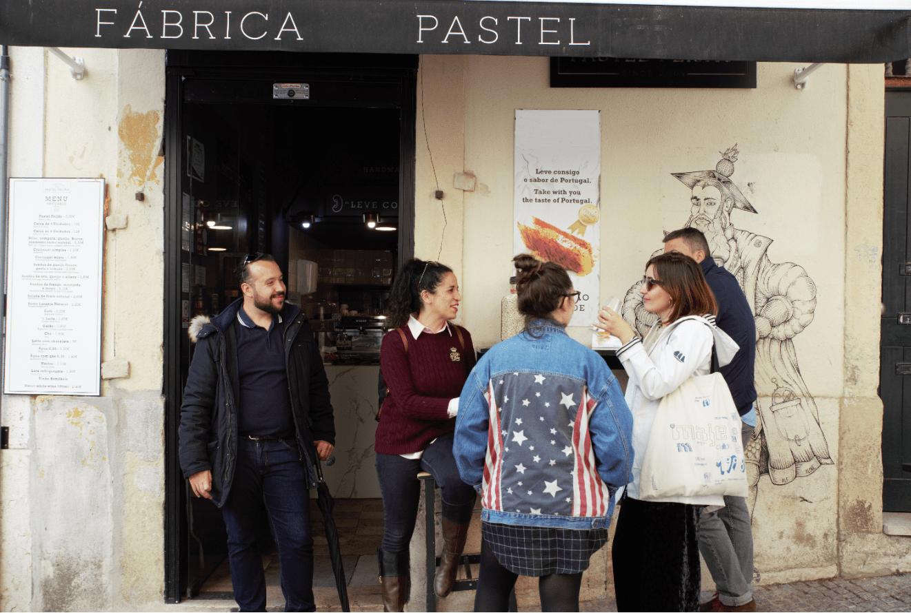 treasures of lisboa food tours in lisbon - group eating desert