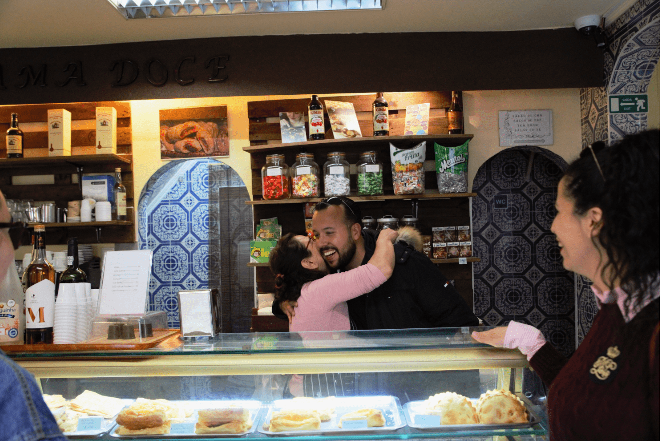 treasures of lisboa food tours in lisbon - guide and pastry shop owner hug