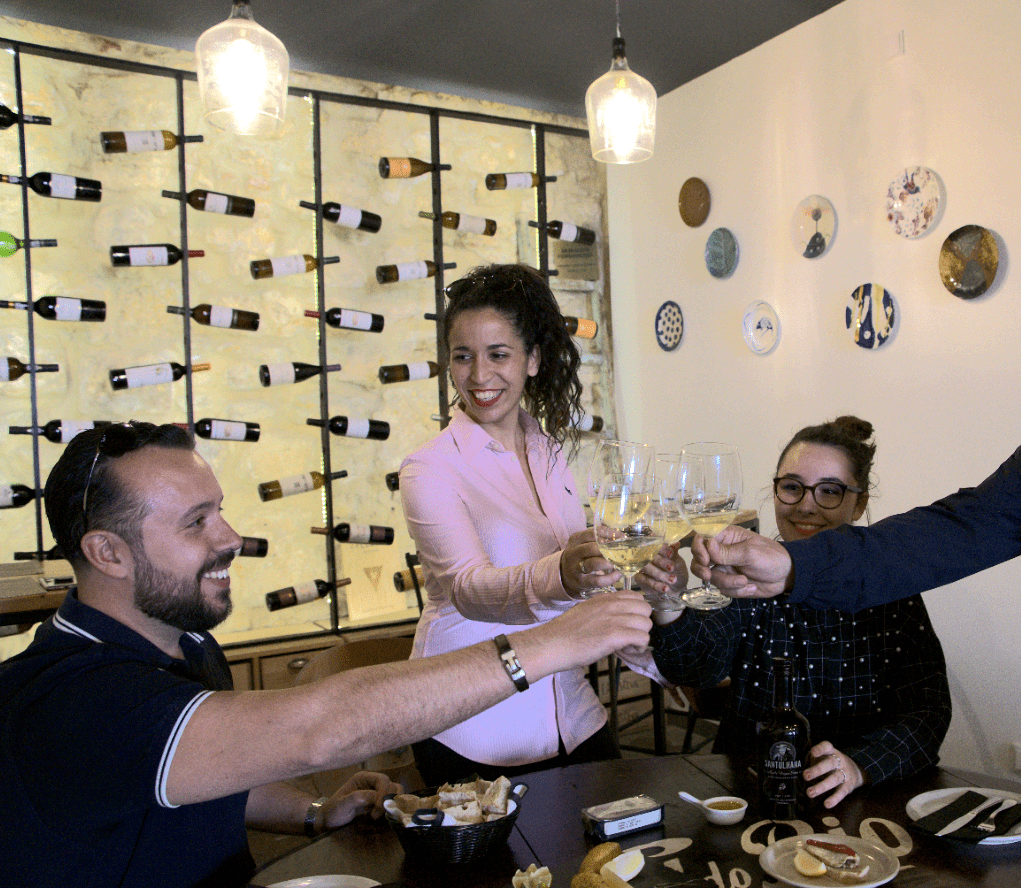 treasures of lisboa food tours in lisbon - group cheering with wine