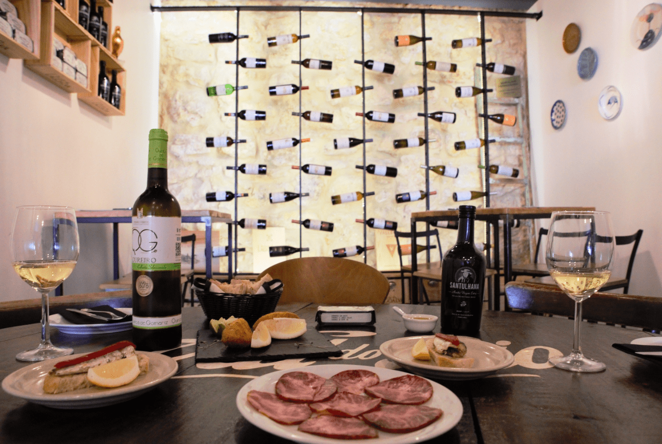 treasures of lisboa food tours in lisbon - table with food and wine